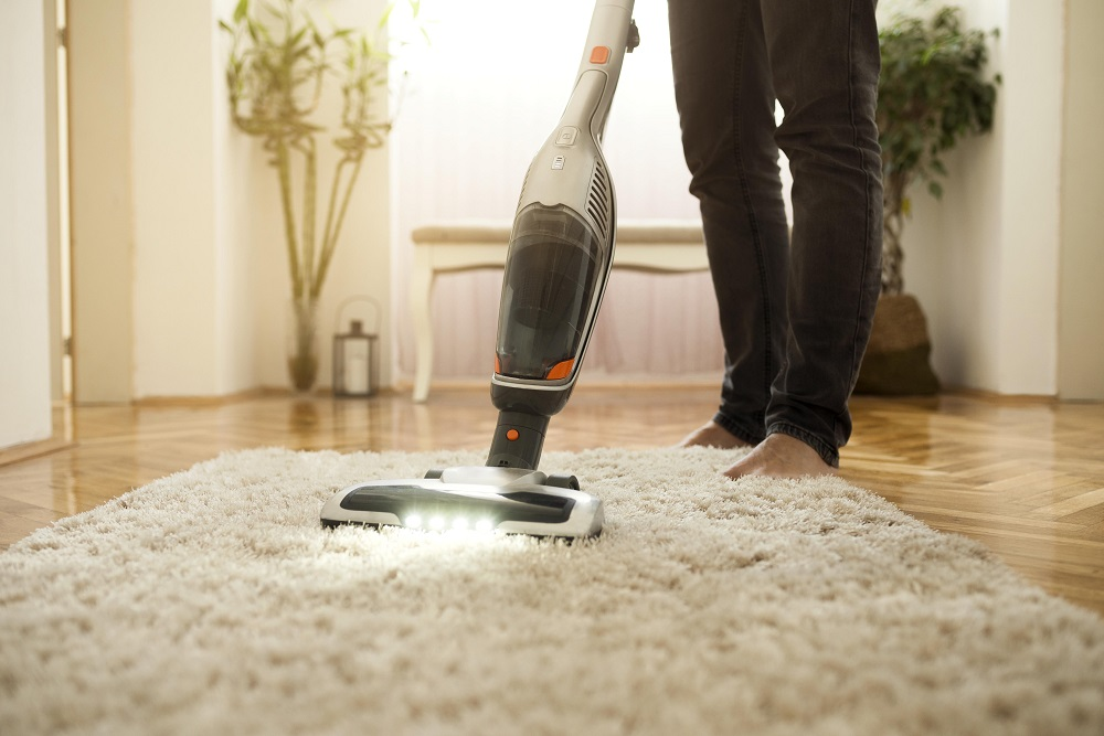 Man cleaning the carpet